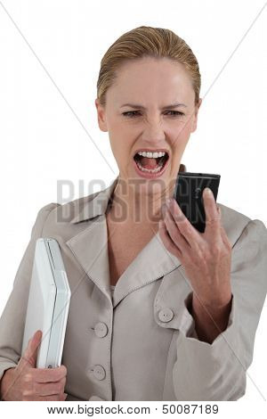 woman looking at her cell phone and screaming