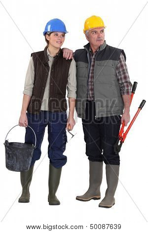 Tradesman and his assistant staring sideways