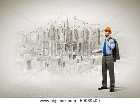 Image of man engineer in helmet with drafts. Construction concept