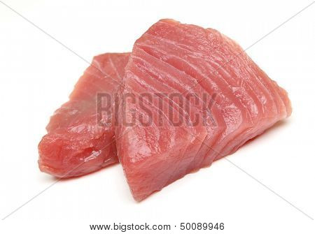 Raw tuna fish steaks on white background.