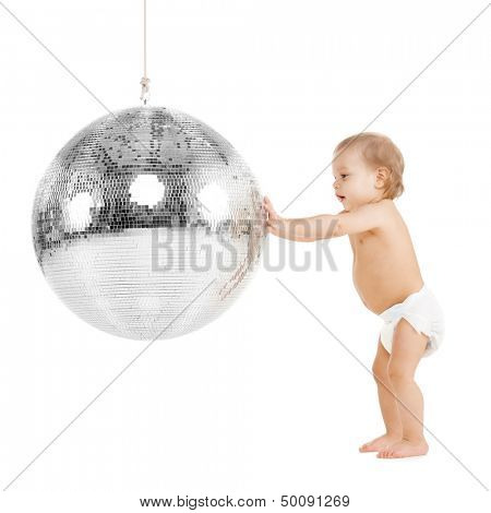 childhood and toys concept - cute little toddler playing with disco ball