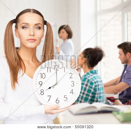education and time management concept - attractive student showing clock
