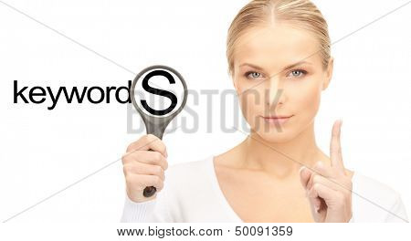 business and seo concept - woman with magnifying glass and keywords word