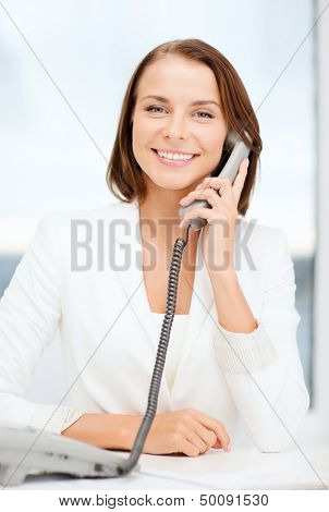 business and helpline concept - businesswoman with rotary phone calling