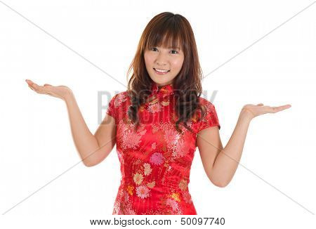 Pretty Asian girl with Chinese traditional dress cheongsam or qipao hands showing blank space. Chinese new year concept, female model isolated on white background.