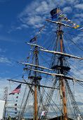 pic of tall ship  - A big two mast tall ship under blue sky in the harbour of Hamilton Ontario