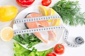 stock photo of salmon steak  - Diet weight loss concept - JPG