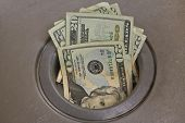 image of twenty dollars  - Economy Like Flushing Money Down The Drain - JPG