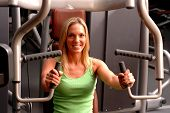 stock photo of beautiful lady  - beautiful blond woman in gym with fitness equipment - JPG