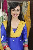 foto of dupatta  - Portrait of an attractive Indian female dressmaker smiling - JPG
