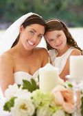 stock photo of marquee  - Bride With Bridesmaid In Marquee At Reception - JPG