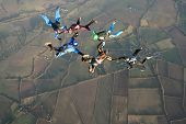 Six Skydivers Doing Formations