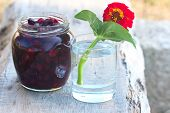 foto of tumbler  - tumbler with red flower and pot with sweet preserve of berry - JPG