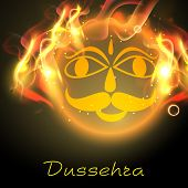 stock photo of ravana  - Indian festival Dussehra concept with illustration of Ravana face in flame - JPG