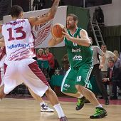 stock photo of unicity  - SAMARA RUSSIA - DECEMBER 02: Konstantinos Kaimakoglou of BC UNICS with ball is on the attack during a BC Krasnye Krylia game on December 02 2012 in Samara Russia.