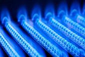 stock photo of combustion  - Blue flames of a gas burner inside of a boiler - JPG
