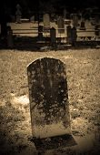 picture of headstones  - spooky old grave and headstone in graveyard - JPG