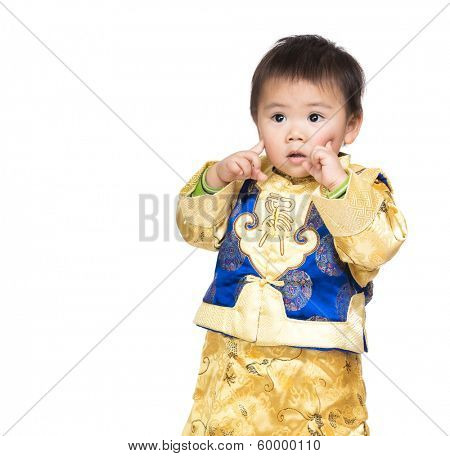 Asian baby boy with chinese costume and finger point to face