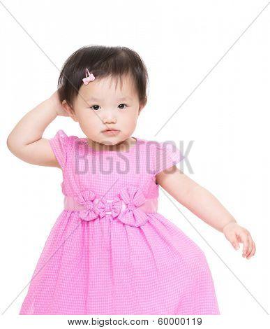 Asian little girl scratch head