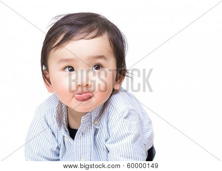 Asian baby boy showing tongue