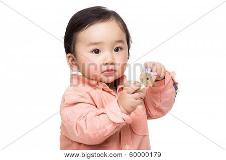 Baby boy play with wooden toy block