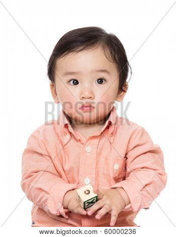 Asian baby boy play with wooden toy block
