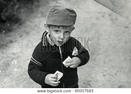 KURSK, USSR - CIRCA 1980s: An antique photo shows portrait of a little boy on the walk