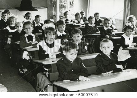 KURSK, USSR - CIRCA 1976: An antique photo shows group portrait of a first-graders of secondary schools.