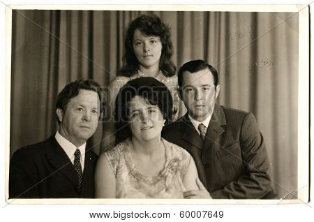 KIEV, UKRAINE, USSR - CIRCA 1977: An antique photo shows portrait of a Soviet family - father, mother and two sons.
