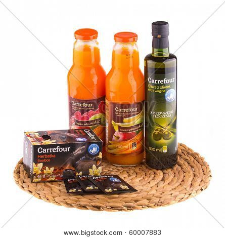 KRAKOW, POLAND - FEB 8, 2014: Products Carrefour in assortment isolated on white. Carrefour SA, founded 1957 - French retailer, operator retail network, the second largest in the world after Wal-Mart.