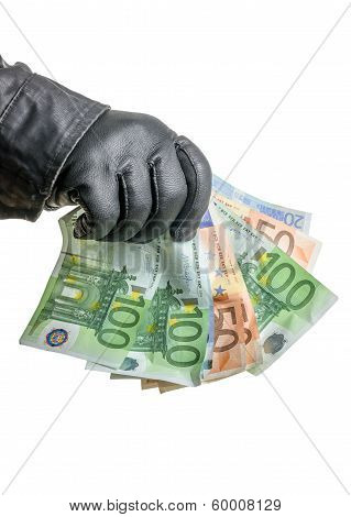 Thief with leather glove is grabbing some bills