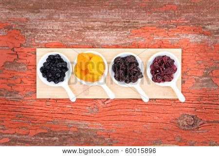 Assorted Dried Berries And Fruit In Ramekins