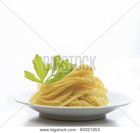 Chinese Yellow Eggs Noodle On White Disk With Green Leaves Of Celery Ready To Eating Meal On White B