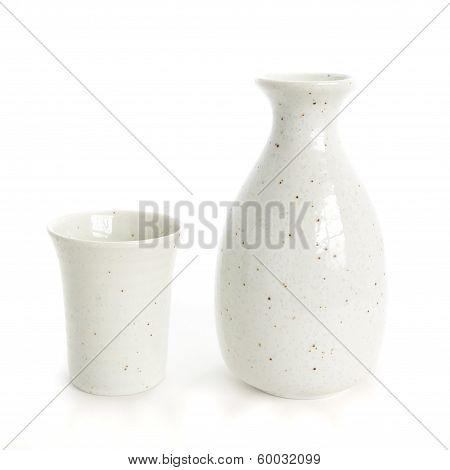 sake bottle and sake cup on white background