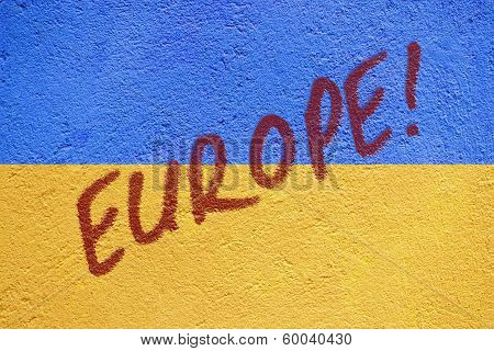 Ukraine Flag Painted On Old Concrete Wall With Europe Inscription
