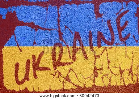 Ukraine Flag Painted On Old Concrete Wall With Ukraine Inscription