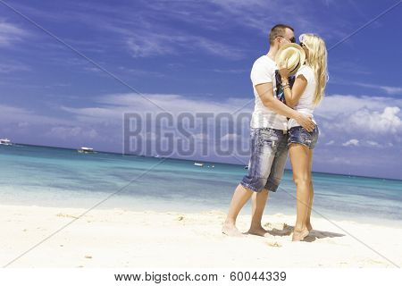 young happy loving couple on tropical background
