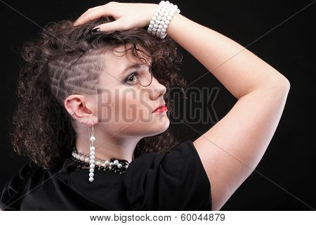 Girl showing her haircut and ear piercing