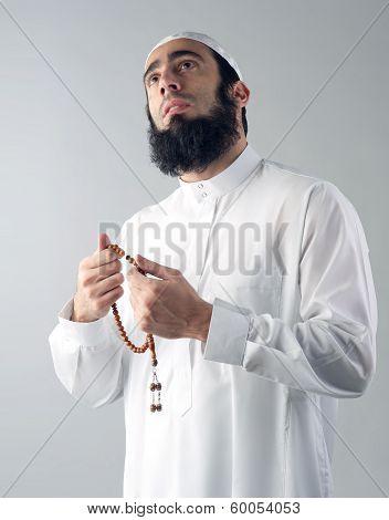 Arabian religious muslim man holding rosemary