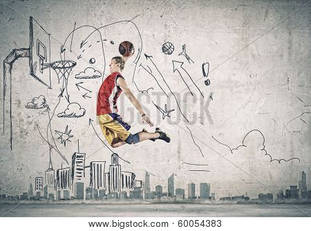 Young man basketball player throwing ball in basket