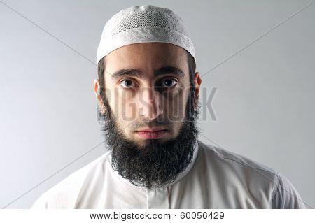 Portrait of an Arabic Muslim man with beard.