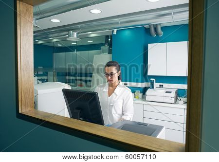 Beautiful Doctor working on the computer in a modern lab