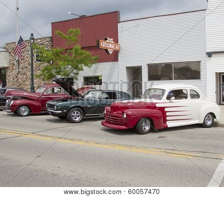 Vintage Red And White Ford Coupe Parked