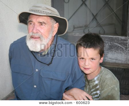 Grandfather With Grandson On Porch