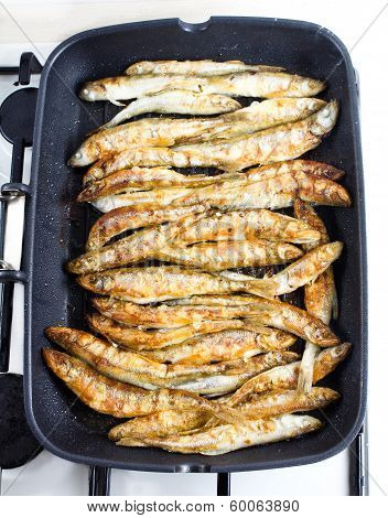 Fried Small Smelt Fish On A Barbecue Grill  Hotplate