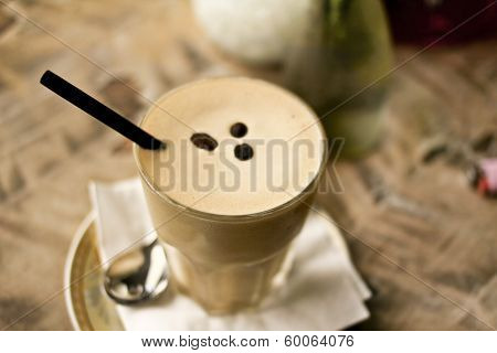 Iced Coffee With Straw In A Glass Cup