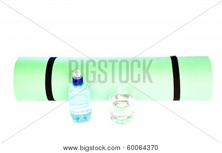 Lightweight foam Yoga Mat roll with bottle of water on white