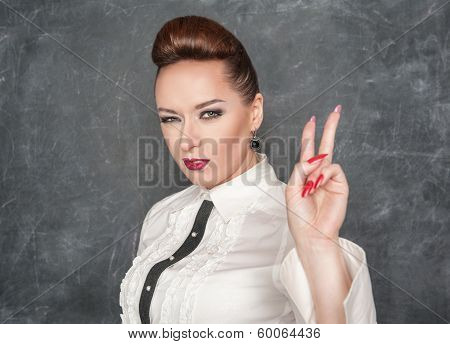 Beautiful Woman Showing Victory Sign