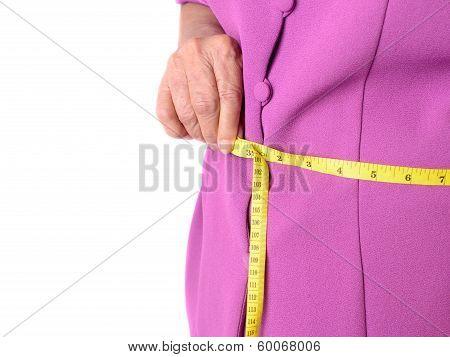 Senior Woman Measuring Her Waist By Centimeter