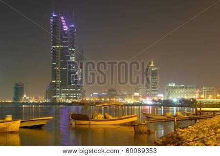 MANAMA, BAHRAIN - AUGUST 25, 2008: Manama city view at night including Bahrain Financial Harbor and Bahrain World Trade Center